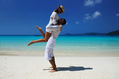 Couple in white on a beach Royalty Free Stock Photos