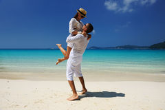 Couple in white on a beach Royalty Free Stock Photo