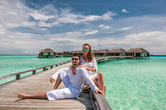 Couple in white on a beach jetty at Maldives Royalty Free Stock Photo