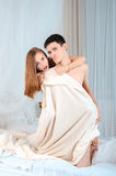 Couple in a white bed Royalty Free Stock Photo