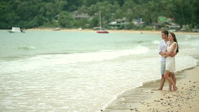 Couple in white clothes on a tropical beach. stock footage