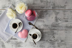Couple white cups with decoration by red hearts on wooden table. Stock Photography