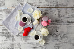 Couple white cups with decoration by red hearts on wooden table. Royalty Free Stock Photo