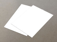 Couple of white flyer. Blank white paper A4 fly-er collection on floor,  flyers Royalty Free Stock Images