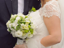 Couple with White and Green Bouquet Royalty Free Stock Photography
