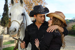 Couple with white horse Royalty Free Stock Image