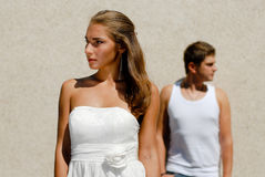 Couple in white looking in opposite directions Stock Images