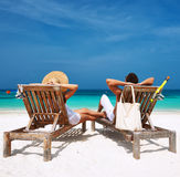 Couple in white relax on a beach at Maldives Stock Image