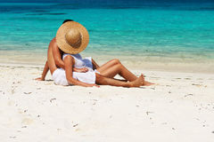 Couple in white relax on a beach at Maldives Royalty Free Stock Photography