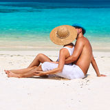 Couple in white relax on a beach at Maldives Royalty Free Stock Image
