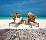 Couple in white relax on a beach at Maldives Stock Photography