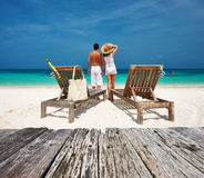 Couple in white relax on a beach at Maldives Royalty Free Stock Photo