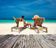Couple in white relax on a beach at Maldives Stock Photo