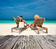 Couple in white relax on a beach at Maldives Royalty Free Stock Photos