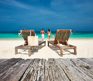Couple in white relax on a beach at Maldives Stock Images
