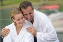 Couple on white robes on outdoor. Couple on white robes on the outdoor Royalty Free Stock Photo