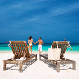 Couple in white running on a beach at Maldives Stock Photos