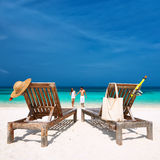Couple in white running on a beach at Maldives Stock Image