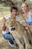 Couple with wild animal Stock Photo