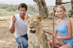 Couple with wild animals Royalty Free Stock Images