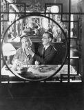 Couple through window in restaurant Royalty Free Stock Photos