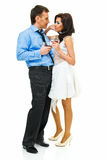 Couple with wine. Happy young couple with wine glasses on white Royalty Free Stock Image