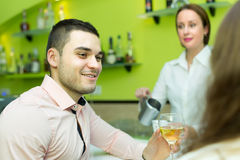 Couple with wine at bar Royalty Free Stock Photo