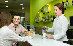 Couple with wine at bar Stock Photo