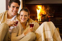 Couple wine fireplace Stock Photo