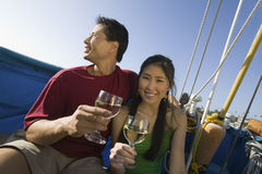 Couple With Wine Glasses On Boat Stock Images