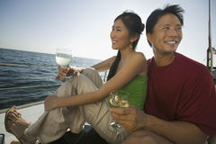 Couple With Wine Glasses On Boat Stock Photography