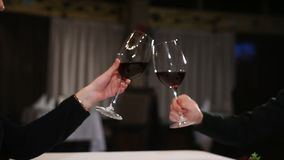 Couple with wine glasses dating and toasting in restaurant.  stock video