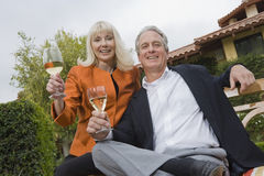 Couple With Wine Glasses In Garden Royalty Free Stock Photos