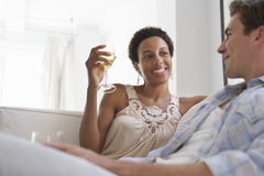 Couple With Wine Glasses In Living Room Stock Photos
