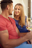 Couple with wine looking at each other romantically Stock Photography