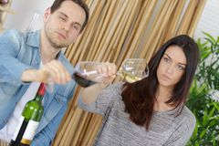 Couple wine tasting on couch. Couple is wine tasting on couch stock images
