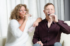 Couple is wine tasting on couch Royalty Free Stock Photo
