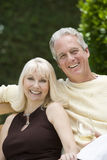 Couple With Wineglass In Garden Royalty Free Stock Photo