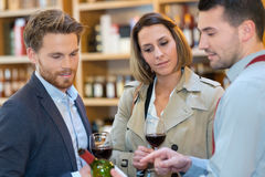 Couple winemakers tasting red wine Stock Images