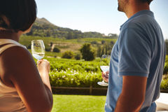 Couple at winery with glass of white wine Stock Photo