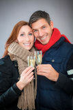 Couple winter champagne Royalty Free Stock Photo