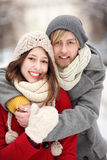 Couple in Winter Clothing Embracing Royalty Free Stock Photography