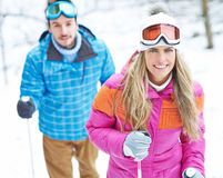Couple in winter doing hiking trip Royalty Free Stock Photo