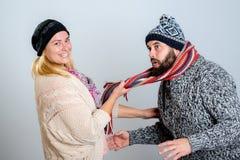 Couple in winter dress joking Royalty Free Stock Photos
