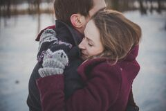 Couple in winter embrace Stock Images
