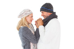 Couple in winter fashion embracing Stock Photo