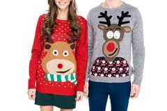 Couple in winter festive sweaters. Partial view of couple in winter festive sweaters isolated on white stock photo