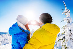 Couple winter heart Stock Images