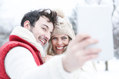 Couple in winter holiday taking Royalty Free Stock Photo