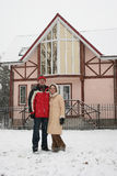 Couple and winter house Stock Images